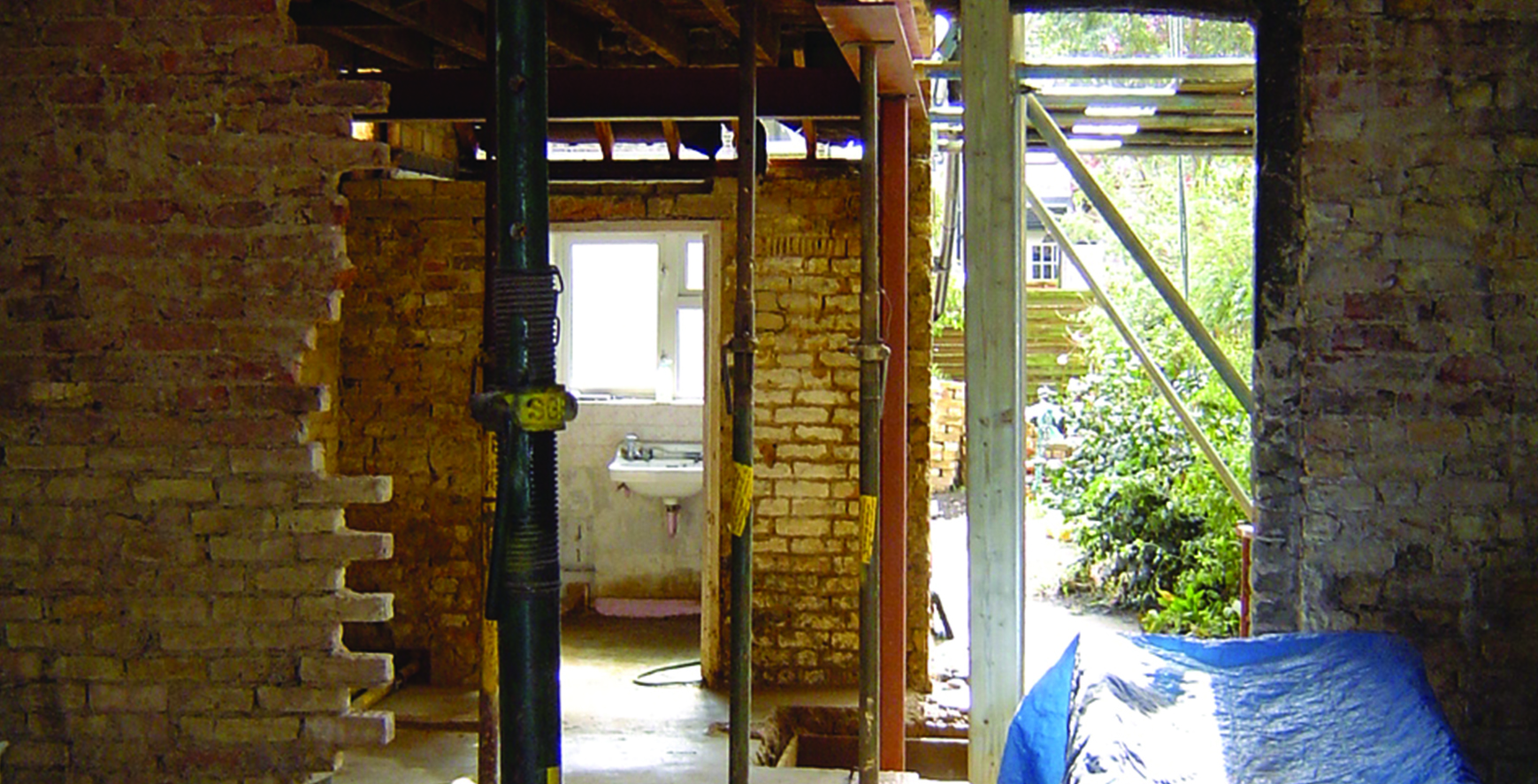 Acrow props to support existing house whilst the structural steel beams are put in place to create and open plan ground floor and new ground floor extension
