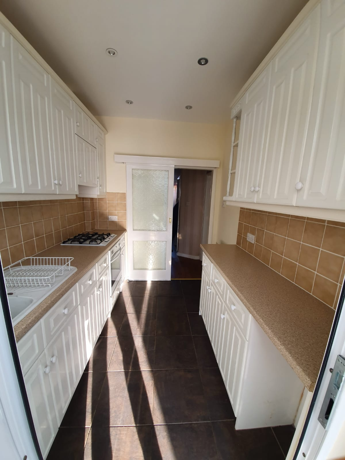 Narrow, cramped kitchen in need of remodelling